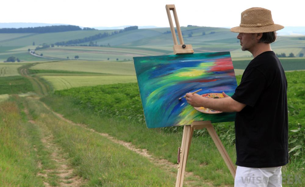 man-painting-on-grass-road
